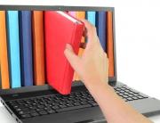 livros saindo do notebook - Fonte - Shutterstock